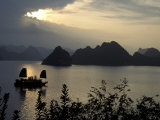 Sunset on Karst Hills and Junk Boats  Ha Long Bay  Vietnam