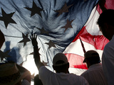 Immigration Rights Demonstrators Hold a US Flag Aloft During a March Along Wilshire Boulevard