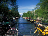 Yellow Bicycle and Canal  Amsterdam  Netherlands