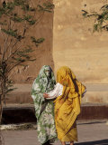 Veiled Muslim Women Talking at Base of City Walls  Morocco