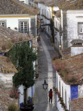 Woman in Narrow Alley with Whitewashed Houses  Obidos  Portugal