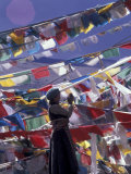 Pilgrim Praying Among Flags  Tibet