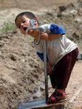 A Young Internally-Displaced Child at a Camp for Displaced Iraqis Who Have Fled Violence