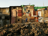 A Child Runs by a Row of Shacks in Novo Mundo Shantytown  Sao Paulo  Brazil