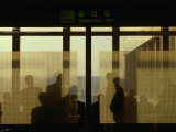 People Silhouetted in Smoking Room at Gimpo Airport  Seoul  South Korea