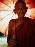 Smiling Monk Holding Umbrella  Mrauk U  Myanmar (Burma)