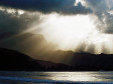 Sun Shining Through Clouds with Mountain Backdrop  Hanalei Beach  Po-Ipu  USA