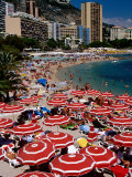 Overhead of Red Sun Umbrellas at Larvotto Beach on Busy Summer's Day  Monte Carlo  Monaco
