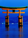 Floating Torii (Gate) at Night with City in Background  Miyajima  Japan