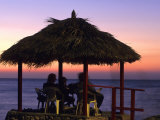 Cliffside Table at Pickled Parrot at Sunset  Negril  Jamaica