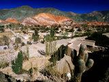 Seven Colours Hill Above Andean Village of Quebrada De Humahuaca, Purmamarca, Argentina Papier Photo par Michael Taylor