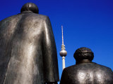 Statues of Karl Marx  Friedrich Engels with Television Tower in Background  Berlin  Germany