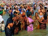 Pilgrims Making Pura or Blessing at Sangam  Sacred Meeting Place of Three Sacred Rivers  India