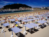 Striped Sunshades at Playa De La Concha with Mt Urgull in Background  San Sebastian  Spain