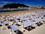 Striped Sunshades at Playa De La Concha with Mt Urgull in Background  San Sebastian  Spain