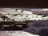Surfers at Dawn Walking into Waves  Cabo Blanco  Peru