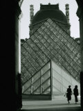 Looking Through an Arched Entrance of the Musee Du Louvre Towards the Glass Pyramid  Paris  France