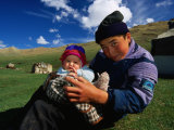 Boy and Baby in Front of Yurt Camp  Kyrgyzstan