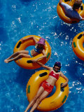 Young Girls Floating in Rubber Rings in Swimming Pool  Gold Coast  Australia