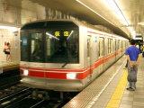 People Waiting to Board Subway Train  Tokyo  Japan