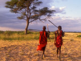 Two Maasai Morans Walking with Spears at Sunset  Amboseli National Park  Kenya