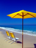 Yellow Chairs and Umbrella on Pristine Beach  Caribbean