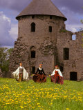 Traditionally Dressed Girls Walk Through Dandelions  Cesis castle  Latvia