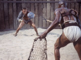 Actor Kirk Douglas Faces Actor Woody Strode in Scene From Stanley Kubrick&#39;s Film &quot;Spartacus&quot;