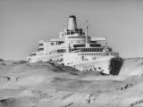 Ocean Liner &quot;Oriana&quot; Passing Through Desert Dunes Going Through Suez Canal