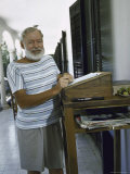 Ernest Hemingway at the Standing Desk on the Balcony of Bill Davis's Home Near Malaga