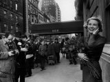 Actress Grace Kelly in Casual Pose with Armful of Roses Standing on Sidewalk During Shopping Trip
