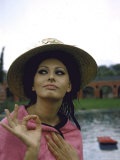 Sophia Loren Wearing a Pink Wrap and Straw Hat Out by the Pool at the Villa