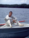 Actor Paul Newman Enjoying a Heineken Beer on the Prow of a Boat