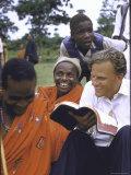 Evangelist Billy Graham Showing His Bible to the Waarusha Warriors Near Mt Meru