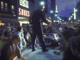 Presidential Candidate Robert Kennedy Standing on Back of Convertible Car While Campaigning