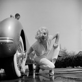 Mamie Van Doren Washing the Whitewall Tires on Her Jaguar