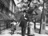 Incredibly Well Dressed Man  Woman and Child Walking by Perfect Brownstone Apartment Buildings