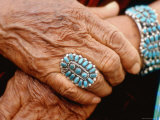 Hands of Navajo Woman Modeling Turquoise Bracelet and Ring Made by Native Americans