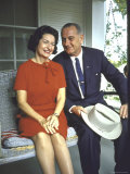 President Lyndon Johnson Sitting on Proch Swing with Wife on Morning Following His Election Win