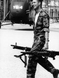 Yankee Papa 13 Helicopter Crew Chief James Farley Carrying a Pair of M-60 Machine Guns