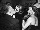 Rubinstein KissingTallulah Bankhead at a Party Thrown by Gossip Columnist Hedda Hopper for Bankhead