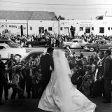 Actress Elizabeth Taylor Wearing Beautiful Long Satin Wedding Gown with Husband Nicky Hilton