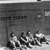 Workers Sitting Against Wall During Lunch Break  at Vega Aircraft Plant  During WWII: Burbank  Ca