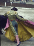 Bullfighter Manuel Benitez  Known as &quot;El Cordobes &quot; Sweeping His Cape Aside a Charging Bull