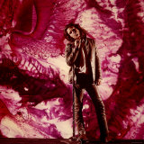 Rock Star Jim Morrison of the Doors Standing Alone in Front of a Purple Psychedelic Backdrop