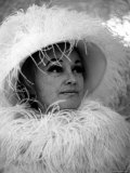 Comedian Phyllis Diller Wearing a Feathered Hat and Boa