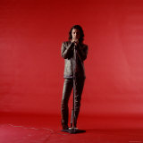 Rock Star Jim Morrison of the Doors Holding Microphone Alone as He Stands Against a Red Backdrop