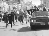Robert F Kennedy Riding Down Street in Convertible on His Campaign