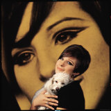 Singer and Actress Barbra Streisand Holding Small Dog in Her Arms