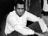 Singer and Actor Paul Robeson Sitting and Resting Arms on Knees Circa 1940